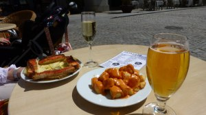 A glass of cava; a glass of beer