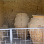 Five-foot-tall urns. Original material at the bottom (dark color).
