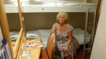 Louise models the bunk beds aboard the Blue Star ferry.