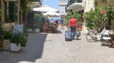 Our landlord Don graciously hauls our bags down Theotokopoulou Street. Goodbye Chania!