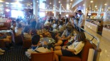 Greek scouts lounge wherever Greek scouts can -- aboard Coraggio on our way to Venice.