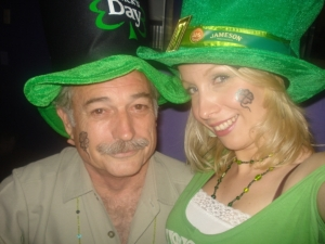 Michael and Yvonne are dressed for Saint Patrick's Day. (From the Que?Pasa website.)