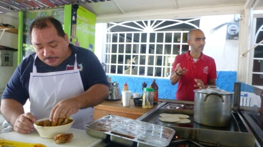 Eduardo prepares rellenos while Memo provides commentary. Best rellenos ever.