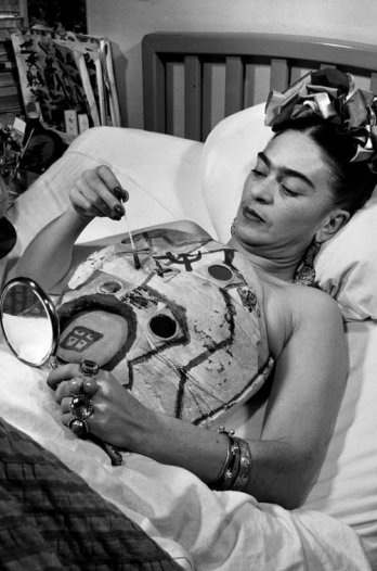 Frida paints her own body cast with the aid of a hand mirror.