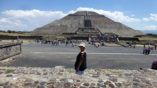Louise stands in the foreground with the Pyramid of the Sun behind