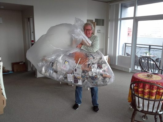 Tom poses with garbage from the first round of IKEA unboxing.