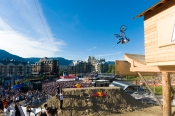 Brandon Semenuk does a backflip tailwhip out of the Kokanee cabin at Joyride. Credit www.crankworx.com/