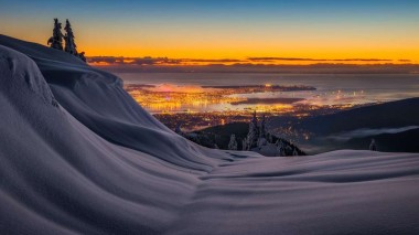 Vancouver from a nearby mountaintop. Credit www.facebook.com/arturstaniszphotography