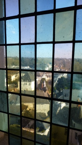 The town as seen through stained glass in the chateau