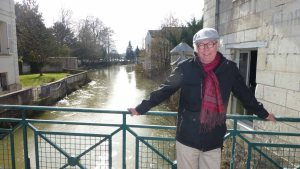 En route, Tom models his new scarf over the Indre River in Loches